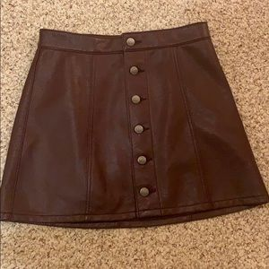 Button down maroon leather skirt.